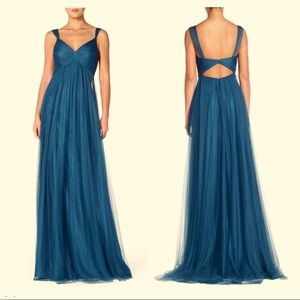 Stunning tulle gown ruched and with a cutout back